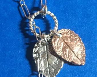 Sterling Silver Lariat with Hand Made Rose Leaf charms in Sterling silver, 24kt Gold Vermeil, and Rose gold.