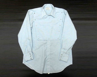 Vintage H Bar C Calvary Western Shirt in Blue with Snap Buttons. Circa 1970's.