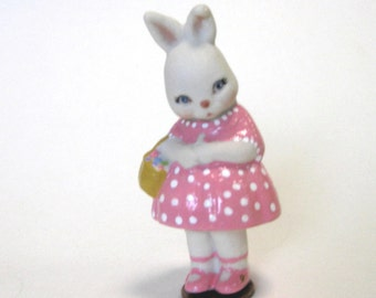 "Bunny 3"" penny bun cast from a vintage mold wearing pink polka dots and holding a basket of eggs"