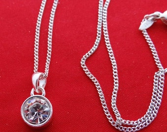 """20% off sale Vintage AVON silver tone 20"""" necklace  with sparkly rhinestone .5"""" pendant  in great condition, appears unworn"""