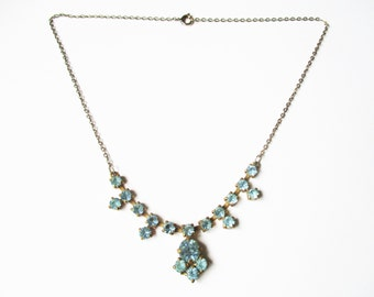 Fifties rhinestone necklace: Opulent princess and brilliant cut turquoise or powder blue rhinestone statement pendant necklace