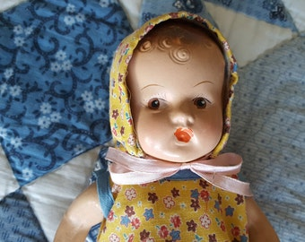 Composition Baby Doll With Yellow Jumper and Bonnet, 9 Inches, Likely From the 30s or 40s, No Markings