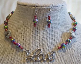 """Beaded Necklace with """"Love"""" Pendant, Purple Irridescent Beads, and Silver Heart Beads"""