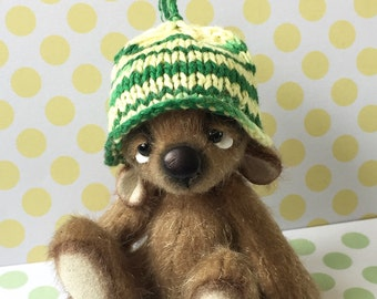 Hand knitted green and yellow striped hat