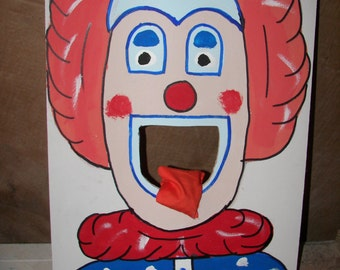 New   orange  haired  clown    circus  games with   4  bean bags