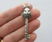 2 White rabbit key pendants antique silver tone K68