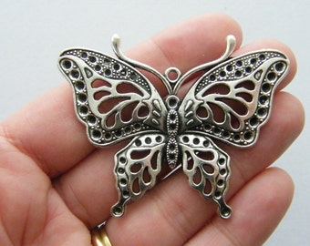 1 Butterfly charm antique silver tone A328
