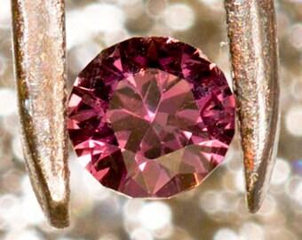 Sapphire Pink .55 carats 5.0mm Rd eye clean Grade AA
