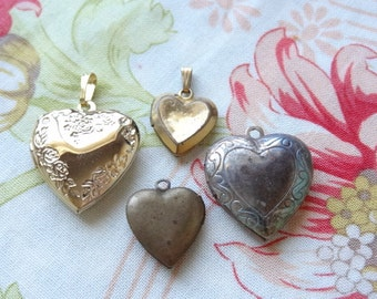 4 Sweet and Vintage Heart Lockets. Gold and silver Tone. Tarnished. One with vintage photo. D255