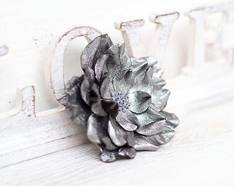Grey metallic leather flower brooch