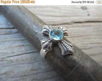 ON SALE Great looking blue topaz cross ring handmade in sterling silver