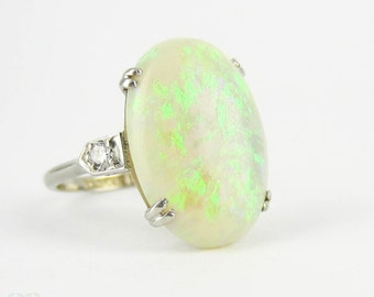 Art Nouveau Opal & Diamond Ring, Antique Platinum Ring with Large Oval Shape Oval Cabochon and Diamond Ring. Circa 1910s.