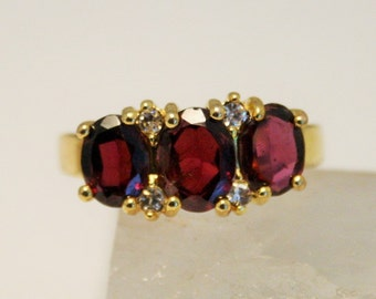 Vintage dress ring. Red glass trio ring. UK size O.  US size 7