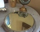 Round mirrored display stand