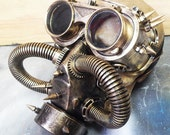 STEAMPUNK GAS MASK - 2 pc set Distressed Gold Steampunk Respirator Mask with Tubes, Spikes and Matching Steampunk Flip Up Goggles