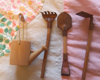 miniature wooden and tin gardening tools