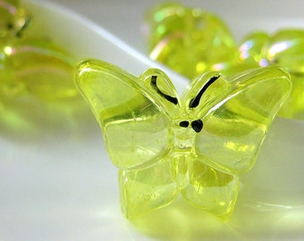 Four (4) Yellow Butterfly Buttons in Lucite Plastic. 22mm x 17mm
