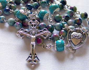 Catholic woman's turquoise blue rosary in shades of turquoise, green, yellow, and magenta
