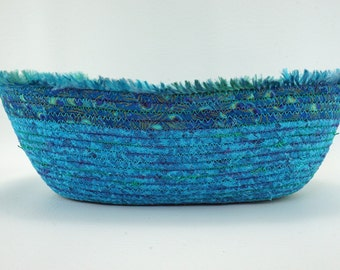 Blue Oval Coiled Fabric Basket:  Shades of Blue with Fringe Yarn Accent