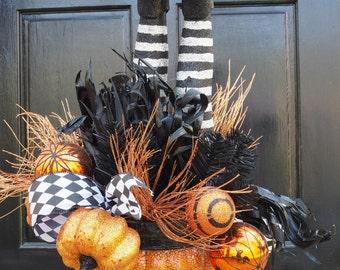 Halloween Witch Legs in a Pumpkin Pot