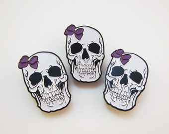 Skull with Bow Enamel Pin