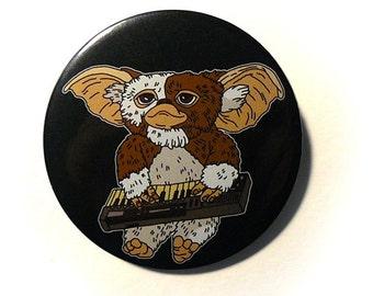 gizmo button pins gremlins illustration