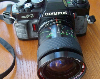 Olympus OM-PC 35mm SLR Camera with Vivitar Series 1 24-70mm f3.8-4.8 Zoom Lens and Case