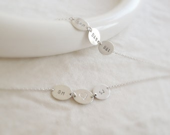 Yours, Mine, Ours (bracelet) - Three sterling silver discs with hand stamped initials
