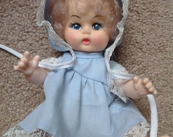 PRICE LOWERED From 30. Dollars to Only 25. Vintage 50-'60s Doll baby in Baby Blue Dress and Bonnet with White Lace Light Brown to Blond Hair