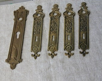 Set of 5 French brass lock and doorbell covers
