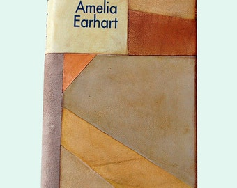 Amelia Earhart a biography bound in leather artistic collage
