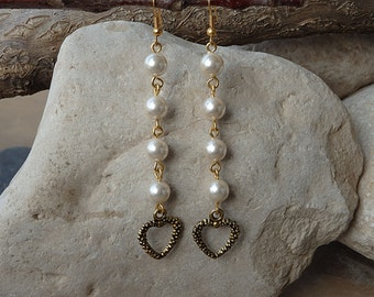 Double heart pearl earrings. Ivory pearl earrings for bridal. Wedding white pearl long love earrings. Heart shaped Pearl and gold earrings.