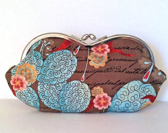 Flowering letters, a sunglass case, coin purse, eyeglass case or small clutch