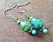 Turquoise teardrop dangle earrings with silver and green glass