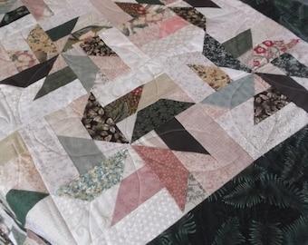 Scrappy pinwheel lap quilt
