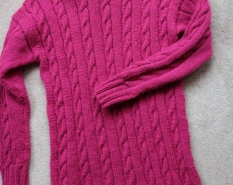 Pink handknitted hip length roll neck cable sweater M / L
