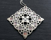 Geometric Pendant - Sterling silver and oxidised copper Handcrafted Geometric Jewellery