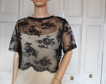 Black lace short sleeve, back fastening scalloped edged bolero/shrug/jacket in UK sizes 8, 10, 12, 14, 16, 18, 20, 22