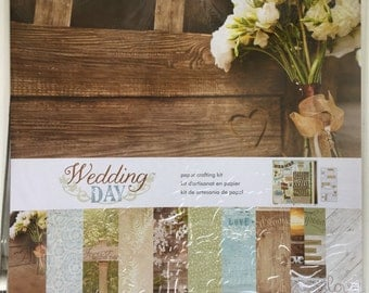 Wedding Day Papercrafting kit by PaperHouse, contains 10-12X12 papers, 1-12X12 yardstick sticker sheet, and 1 puffy word sticker for album