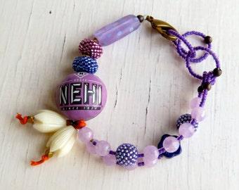 Through the Grape Vine - handmade artisan bead bohemian bracelet in purple and orange   - Songbead UK, narrative jewellery
