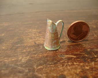 dollhouse miniature. very small copper jug oxidated