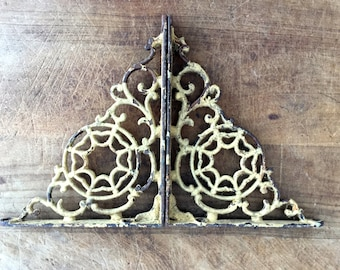 Antique pair of wrought iron brackets