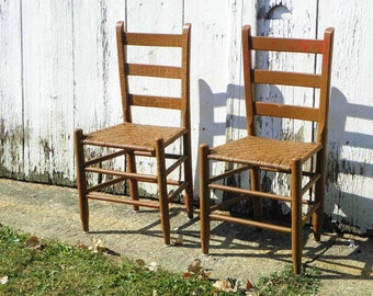 Pair antique rustic rush-seat hearth chairs, chippy butterscotch overcoat with cream, red and teal highlights  PICK UP ONLY