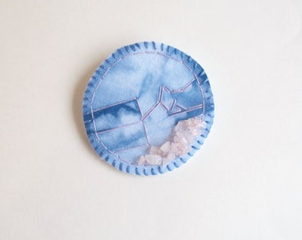 Shibori dyed brooch with hand embroidery and rose quartz beads wool and cotton felt backing indigo Textile jewelry An Astrid Endeavor
