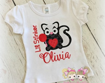 "Girls Valentine's Day shirt - ""Little stinker"" skunk shirt for - personalized Valentine's Day themed shirt with skunk - skunk with lollipop"