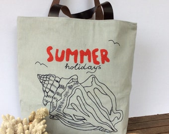 Sea shell hand embroidered on Blue canvas tote bag ,genuine leather handles, summer tote, city tote, all to carry, shopper,unique,chic,