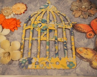 Horizontal 5x7 card, bird in cage, butterflies and flowers, matte card stock covered with decorative paper and three dimensional stickers