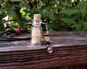snake vertebrae & ribs bottle pendant. real bones. snake bones.
