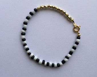 Sale *** Black, white, and gold single strand bracelet