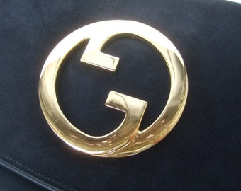 GUCCI Sleek Black Suede Gilt Metal G.G Emblem Clutch c 1970s